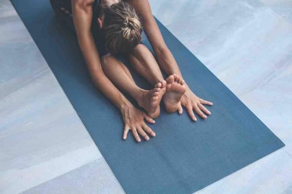 A yogi on her mat
